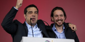 Alexis Tsipras, leader of Greece's Syriza left-wing main opposition party, left, puts his arm around the shoulder of Pablo Iglesias leader of Spanish Podemos left-wing party after a pre-election speech at Omonia Square in Athens on Thursday, Jan. 22, 2015. Prime Minister Antonis Samaras' New Democracy party has failed so far to overcome a gap in opinion polls with the anti-bailout Syriza party ahead of the Jan. 25 general election. (AP Photo/Lefteris Pitarakis)