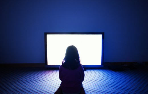 Girl sitting in front of television