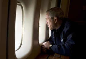 UNSPECIFIED - AUGUST 31:  In this handout photo provided by the White House, U.S. President George W. Bush looks out over devastation from Hurricane Katrina as he heads back to Washington D.C. August 31, 2005 aboard Air Force One. Bush cut short his vacation and returned to Washington to monitor relief efforts for Hurricane Katrina.  (Photo by Paul Morse/White House via Getty Images) *** Local Caption *** George W. Bush