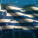 stock-footage-greece-under-water-sea-torn-flag-loop-animation-k-resolution-ultra-hd-uhd