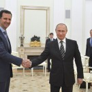 Russian_President_Putin_shakes_hands_with_Syrian_President_Assad
