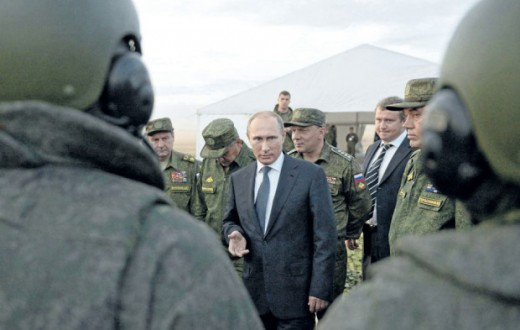 Kremlin Pool Photo/Associated Press   Russian President Vladimir Putin meets with officers after military exercises at Donguz range in Orenburg region, Russia.    ORG XMIT: MOSB505