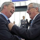 European Commission President Juncker jokes with Farage, leader of the UKIP and MEP, ahead of a debate at the European Parliament in Strasbourg